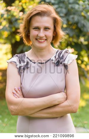 Portrait of Attractive Smiling Caucasian Ethnicity Young Woman in the park