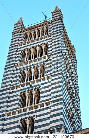 Siena Cathedral (Duomo di Siena) bell tower. Siena is italian medieval town, capital of Siena province, Tuscany, Italy. Historic centre is UNESCO World Heritage Site.