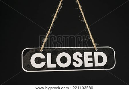 Close up shot of a closed shop sign