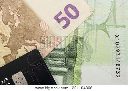 Close up shot of a bunch of euro bills and credit card