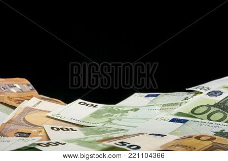 Close up shot of euro bills with black background