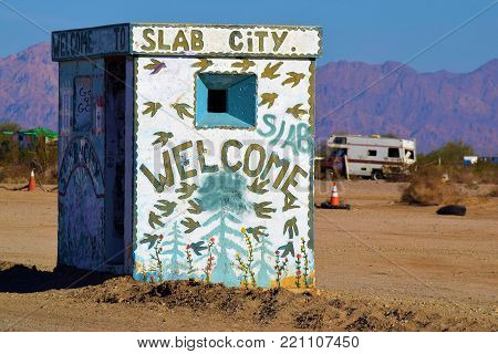 January 2, 2018 in Slab City, CA:  Building with maps and information including a Welcome to Slab City Sign taken in Slab City, CA where people can camp and visit this artistic bohemian community