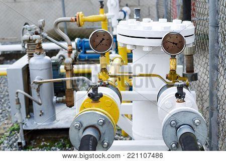 Pressure gauges on the compressor at a gas station for fuel filling cars.