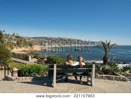 Mother and daughter look at view from Recreation Point Laguna Beach in California