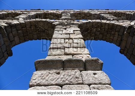 Roman aqueduct in Segovia, Spain; seen from below