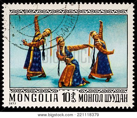 Moscow, Russia - January 08, 2018: A stamp printed in Mongolia, shows Mongolian folk dance, series