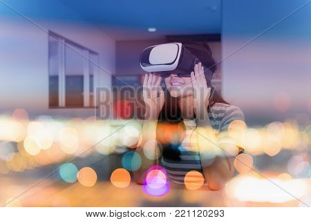 Double exposure concept of young woman playing virtual reality goggles.