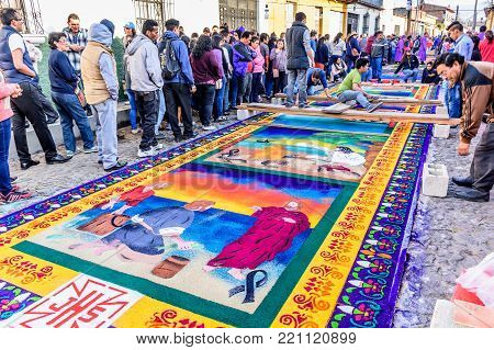 Antigua, Guatemala -  April 2, 2017: Making dyed sawdust carpets for Lent procession in town with most famous Holy Week celebrations in Latin America