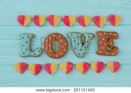 Word love from baked cookies. Cookies with dots in shape of word love. Valentines Day background.
