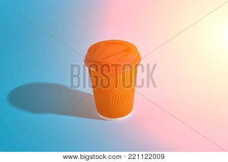 Hot coffee in brown paper cup with black lid on blue background with shadow, blurred and soft focus image. Still life. Copy space. Sun flare