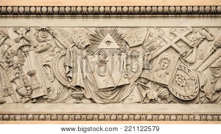 Christian religious symbols with the eye of providence on a 19th century relief in Rome People's Square