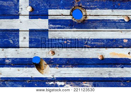 Greece flag painted on old weathered boards