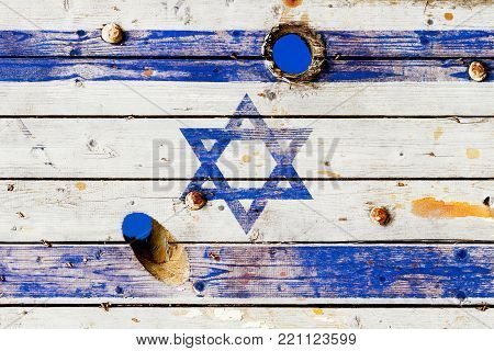 Israeli flag painted on old weathered boards