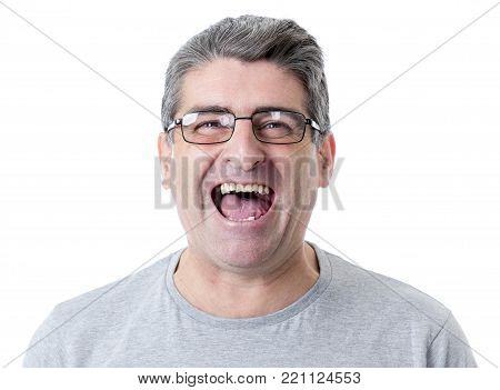 portrait of mature white man 40 to 50 years old smiling happy showing nice and positive face expression isolated on grey background in feelings and emotions concept