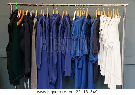 Close up on clothes hanging on the rack