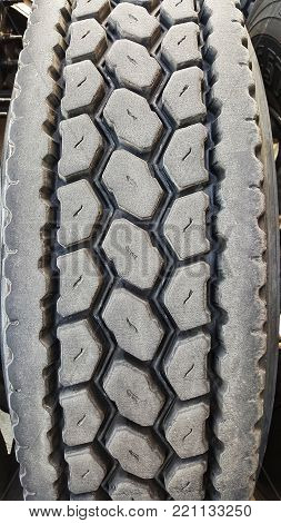 Large semi truck tire treads close up