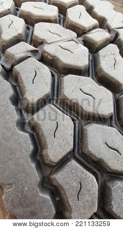 Semi truck tire with tread close up.