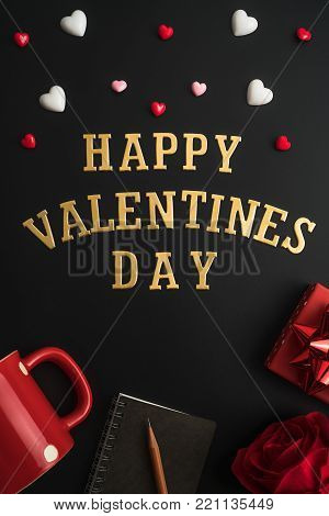 Flat view of notepads with valentines hearts and decoration on dark background with copy space. Symbol of love. Happy Valentines Day background.Saint Valentine's Day concept. Can be used for celebrations valentines day.