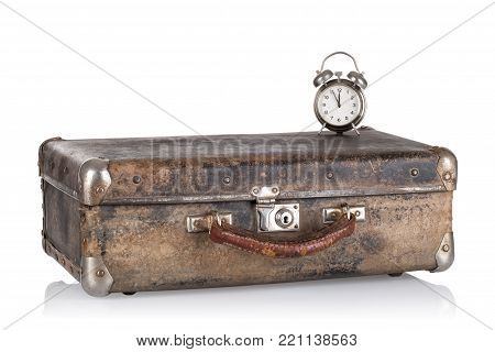 Ancient leather suitcase with clock isolated on white background. The concept of time travel.