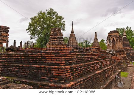 Ruin And Ancient Pagoda On Higher Ground In Sukhothai