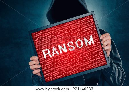 Ransomware computer virus concept, hacker with monitor screen. Internet and cyber security concept