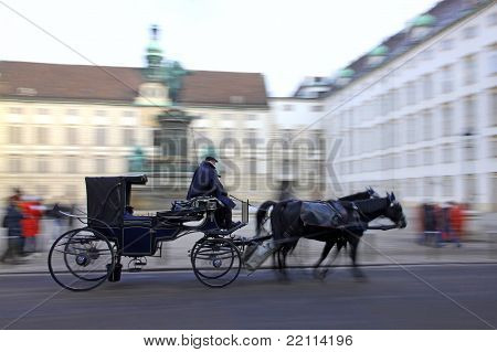 Horse-driven carriage at Hofburg palace in Vienna, Austria poster