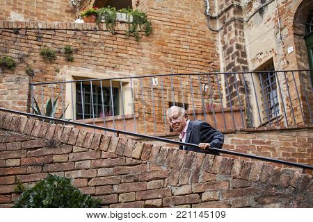 Tuscany, Italy - September 27, 2017: Typical narrow street in an Italian village in Province of Siena, Tuscany, Italy