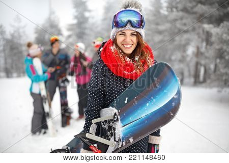 Female snowboarder hold snowboard and going to snowboarding