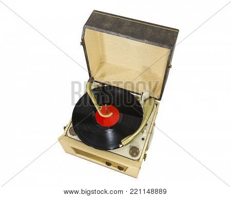 Old record player with album isolated on white.