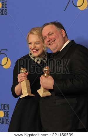 LOS ANGELES - JAN 7:  Elisabeth Moss, Bruce Miller at the 75th  Golden Globes Press Room at Beverly Hilton Hotel on January 7, 2018 in Beverly Hills, CA