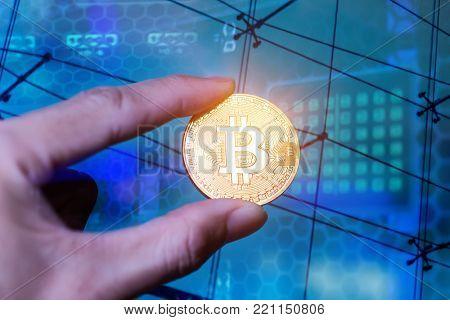 Hand holding golden Bitcoin, coin virtual money.