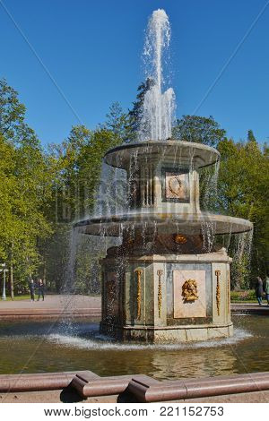 PETERHOF, ST. PETERSBURG, RUSSIA - JUNE 4, 2017: One of Roman fountains in Peterhof Park. These two identical and symmetrical fountains erected in 1739, rebuilt in 1800, and restored in 1949