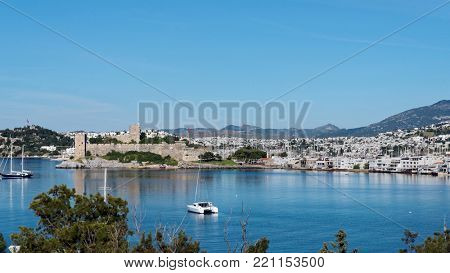 BODRUM, TURKEY - APRIL 13, 2014: View to the St. Peter's castle, harbor, and city. Built in XV century, now the castle housed the Museum of Underground Archeology