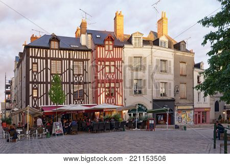ORLEANS, FRANCE - SEPTEMBER 10, 2013: People resting in the street cafe in the historic center of city. Orleans belongs to the Loire Valley sector, which was inscribed as a World Heritage site