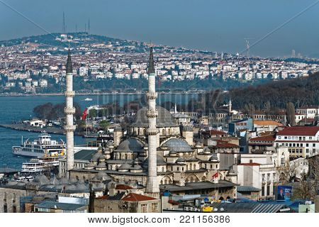 ISTANBUL, TURKEY - MARCH 23, 2014: Cityscape with ferry boat traffic across Bosporus strait. The ferry is the fastest and cheapest way to traverse Bosporus strait