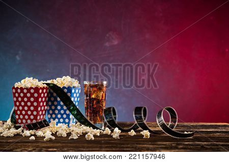 Boxes of popcorn on blue and red background, close-up.
