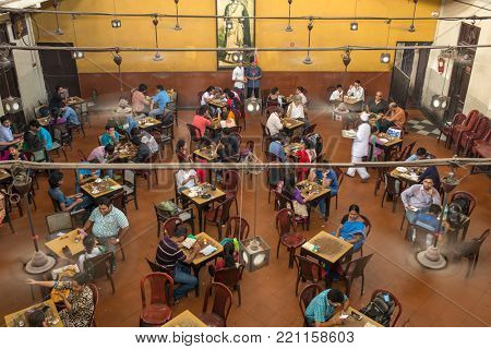 Kolkata, India - April 4, 2017: Visitors of popular Indian Coffee House having lunch in Kolkata, India. The India Coffee House chain was started by the Coffee Cess Committee in 1936 in Bombay.