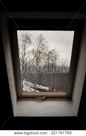 Closed window view on the moutain hills and trees Bieszczady Moutains Poland