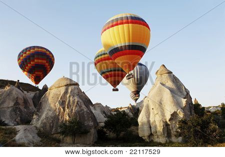 Hot Air Balloons Over Cappodocia Terrain