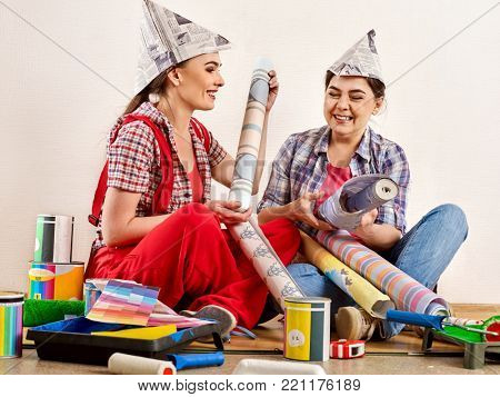 Repair home women holding bank with paint for wallpaper. Elderly mother and daughter renovation apartment on isolated. Home renovation. Friendly family relationships. Loan for housing for families.