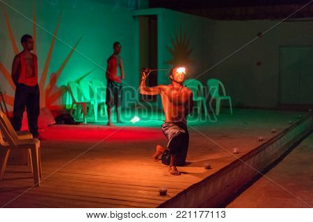 HURGHADA, EGYPT - APR 9, 2013: Fire eaters show at Three Corners Sunny Beach hotel in Hurghada. Three Corners is Belgian company with 11 hotels at Red Sea in Egypt and one in Budapest, Hungary.