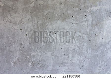 Unpainted concrete grey wall. Concrete wall. Grey wall. Repairs. Building. Background