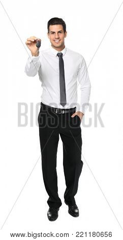 Salesman in formal clothes holding car key on white background