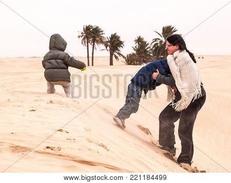 tourist family in the desert of sahara ,douz,tunisia