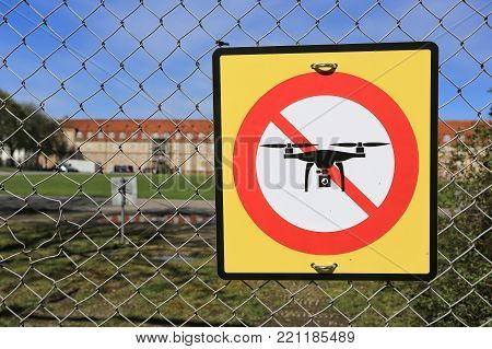 prohibition sign to fly with drones on the fence. No drone zone.