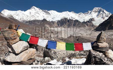 Mount Cho Oyu with prayer flags - way to Cho Oyu base camp, gokyo valley, Everest area, Sagarmatha national park, Khumbu valley, Nepal