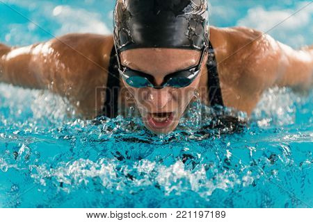 Professional swimmer, swimming race, indoor pool, close up