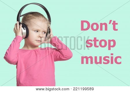 A little girl with headphones listening to music. Isolate. The inscription Dont stop music . Beautiful card.