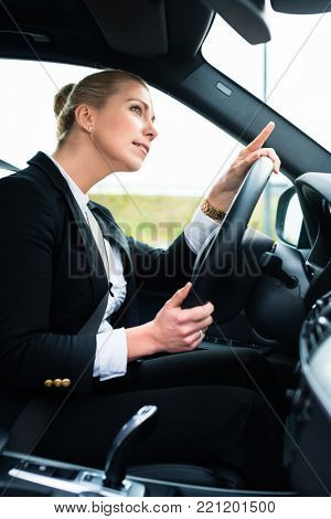 Woman in car being angry and cursing other driver