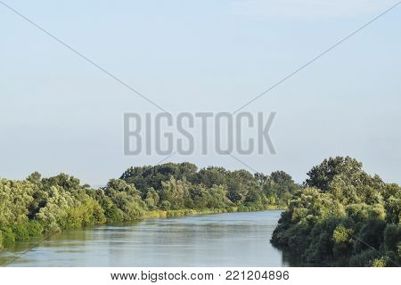 River Kuban. Water smooth surface and coastal woods